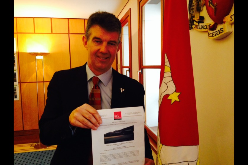Minister Laurence Skelly with sale papers