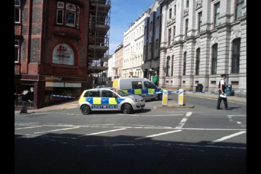 The police cordon on Athol Street yesterday