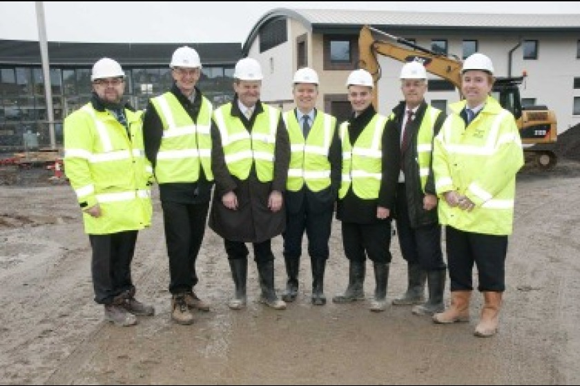 Political members and staff from the Department of Education and Children visiting the site
