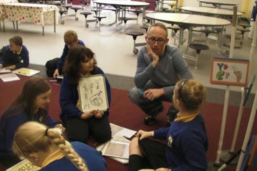 Chris Ewan with local school children