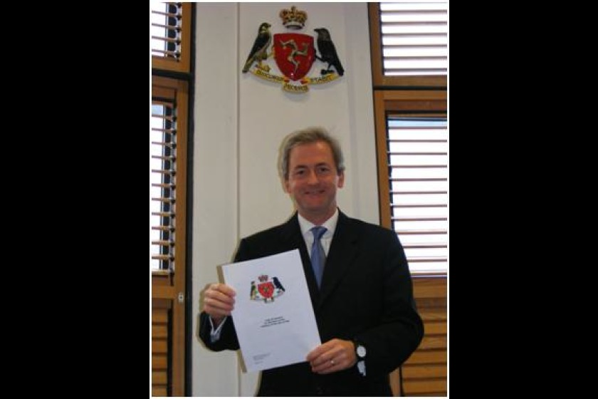 First Deemster David Doyle with the new Code of Conduct for Members of the Judiciary of the Isle of Man