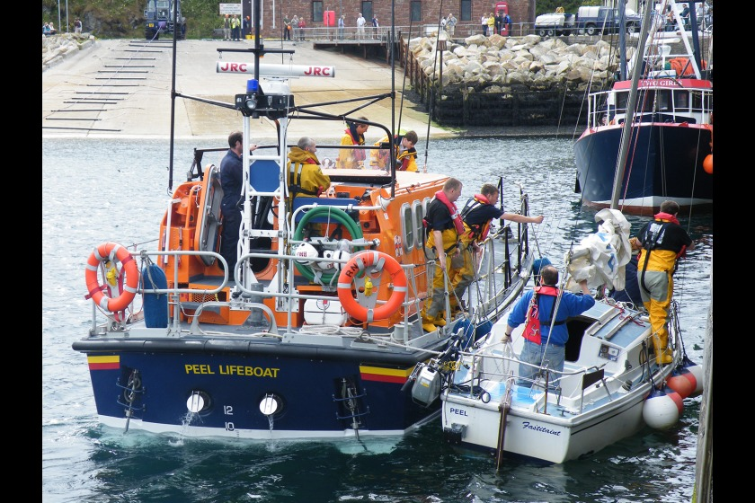 Fastitaint being towed into Peel by the lifeboat