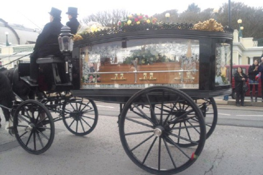 Sir Norman Wisdom's coffin as it passed the Villa Marina