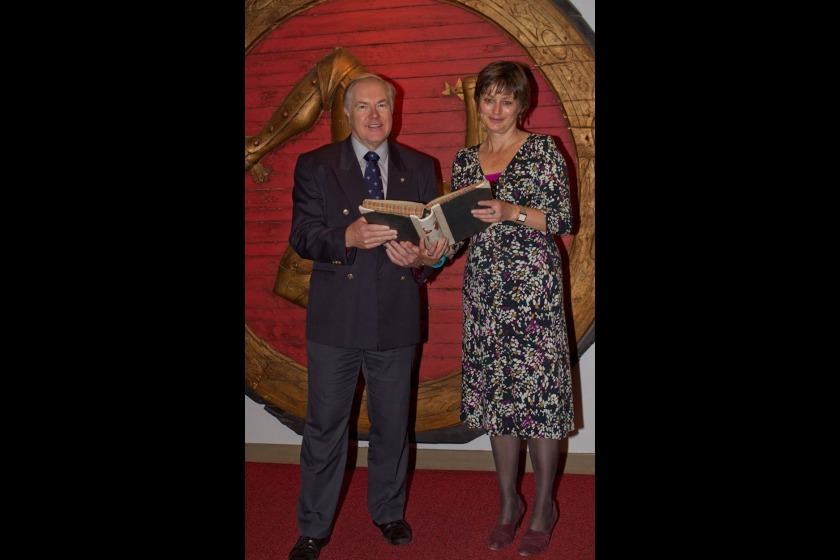 Kevin Williams of the Manx Association of South Africa hading the archives over to Manx National Heritage Archivist Wendy Thirkettle