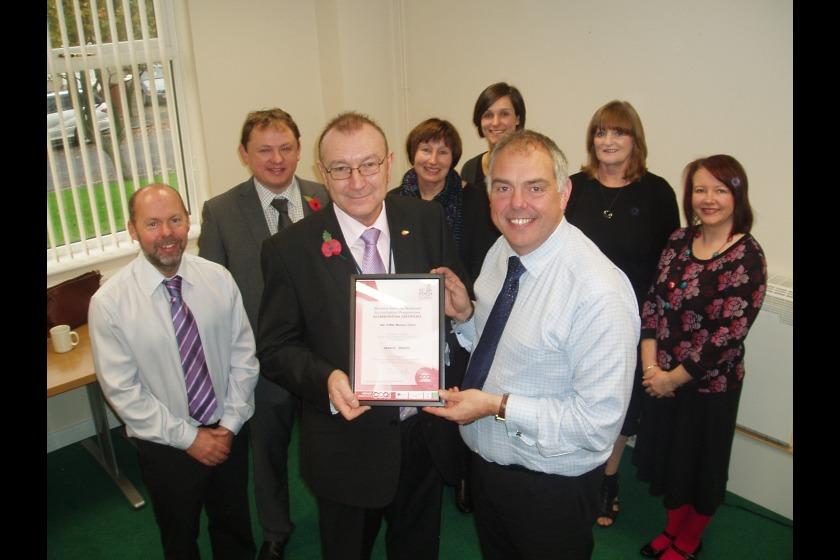 Social Care political member Bill Malarkey presents to certificate of accreditation