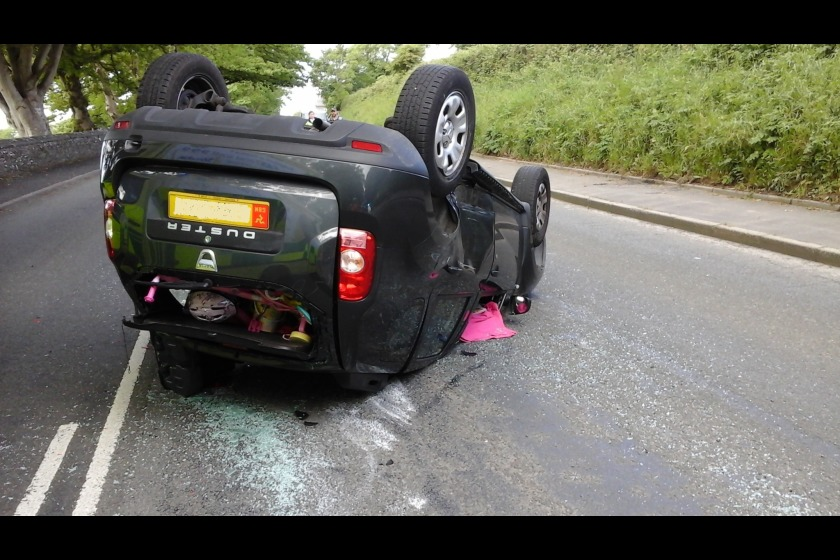 A woman and two children were in the car when it overturned following a collision in Santon this morning.