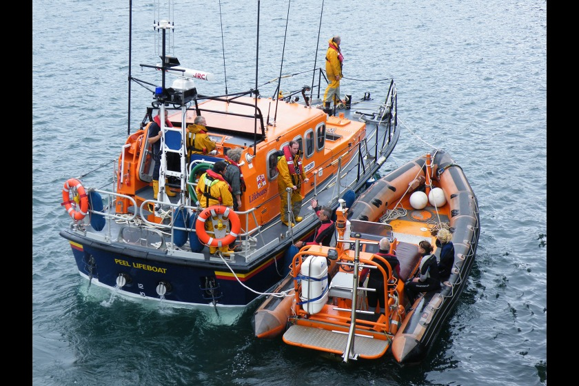 Sea Eagle being towed by Peel Lifeboat