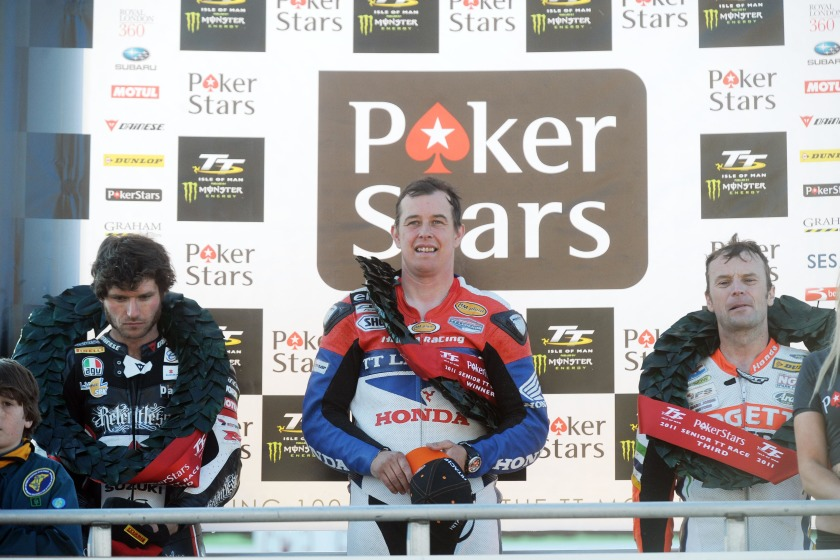 John McGuinness (centre) won yesterday's Senior Race, with Guy Martin (left) in 2nd and Bruce Anstey (right) in 3rd