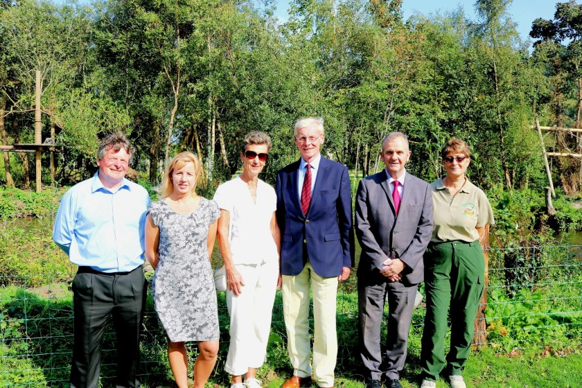 David Cretney MLC, Member of DEFA with responsibility for the Curraghs Wildlife Park; Kathleen Graham, the park's General Manager; His Excellency and Lady Gozney; Richard Ronan, Minister for Environment, Food and Agriculture, and Kim Etherton, Chairman of the Friends of the Curraghs Wildlife Park, at the silvery gibbons' enclosure.
