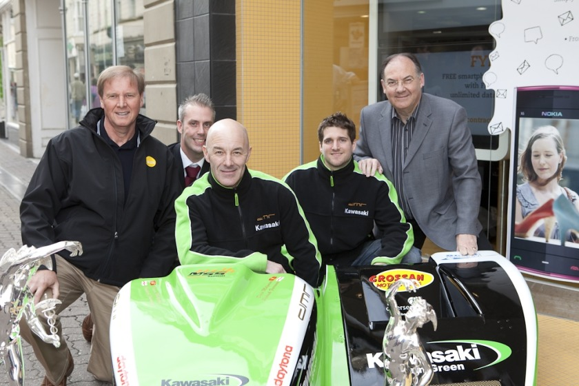 Sure's Mike Stanton and James Hewitt with sidecar riders Dave Moylneux and Patrick Farrance, and Geoff Corkish MHK