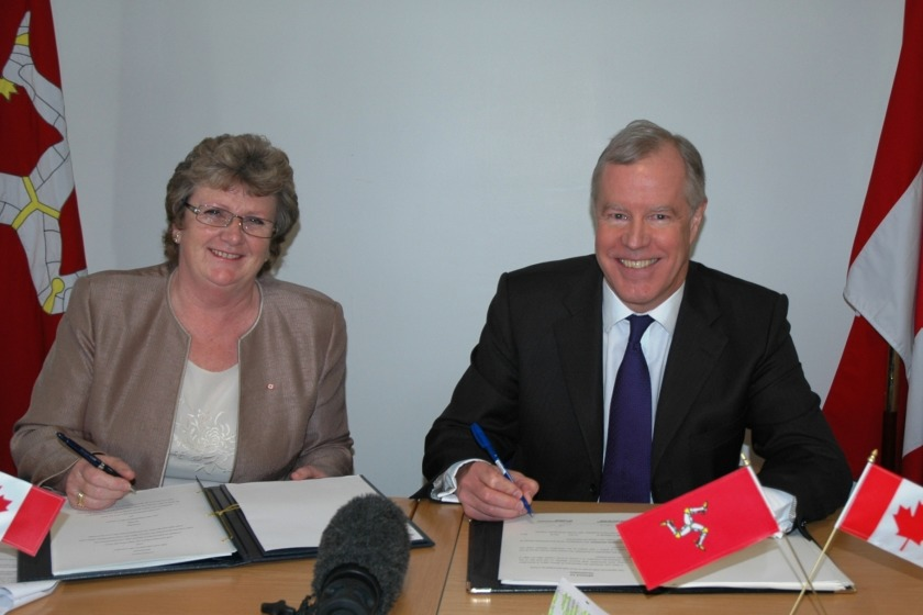Treasury Minister Anne Craine and Canadian High Commissioners James Wright signing the agreement this morning