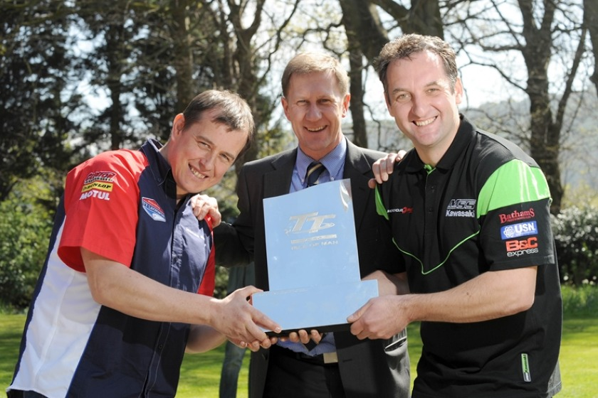 John McGuinness (left) and Michael Rutter (right) with race sponsors SES' Managing Director Mark Guthrie